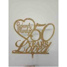 Anniversary cake topper with heart